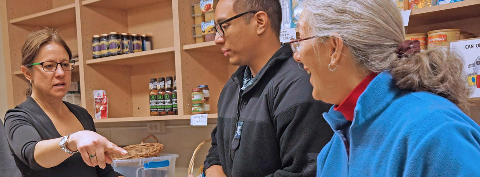 Volunteers inside the Saratoga Food Pantry